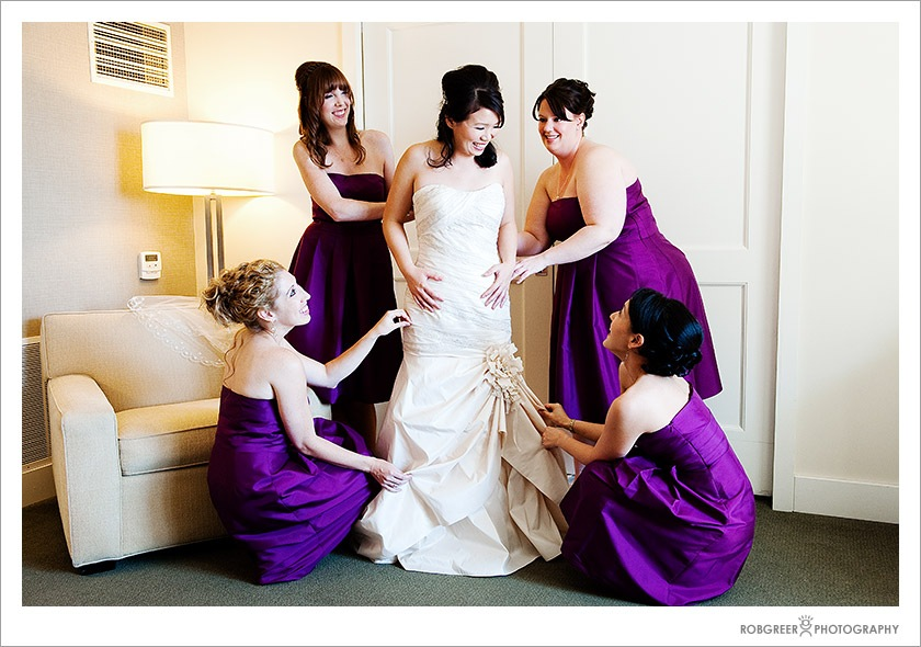 At the Westin in Pasadena, the bridesmaids help the bride.