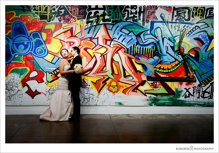 "Wedding portrait in front of ""Calligraffiti: Writing in Contemporary Chinese and Latino Art"" exhibit at the Pacific Asia Museum in Pasadena"